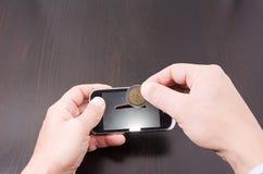 El coste de teléfonos móviles Imagen de archivo libre de regalías