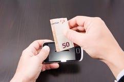 El coste de teléfonos móviles Fotografía de archivo