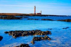 El Cotillo beach Toston lighthouse Fuerteventura Royalty Free Stock Photo