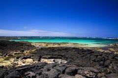 El Cotillo - Faro del Toston: Natural pools between black volcanic rocks and turquoise ocean horizon north Fuerteventura against stock images