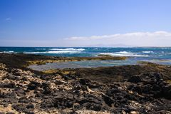 El Cotillo - Faro del Toston: Panoramic view on rocky rough coastline with natural lagoons and pools in north of Fuerteventura royalty free stock photos