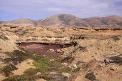 EL Cotillo, Fuerteventura del norte: Visión sobre paisaje seco en las colinas foto de archivo