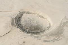 El cráter en la arena Fotos de archivo