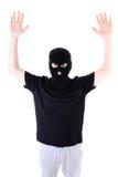 El criminal entregado en una máscara Imagen de archivo libre de regalías
