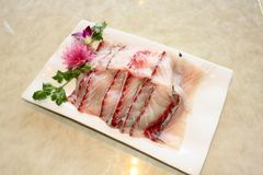 El crisol caliente sirve el sashimi Foto de archivo