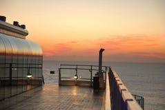 El cruzar el puesta del sol Imágenes de archivo libres de regalías