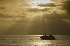 El cruzar en la puesta del sol Foto de archivo libre de regalías