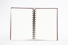 El cuaderno abre dos paginaciones en el fondo blanco Fotos de archivo