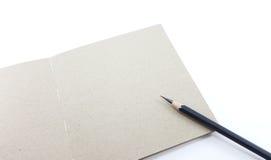 El cuaderno con el lápiz y el espacio para escriben Imagenes de archivo