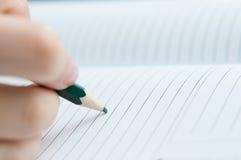El cuaderno escribe imágenes de archivo libres de regalías