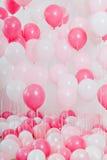 El cuarto con los globos rosados Fotografía de archivo