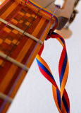 El Cuatro Venezuelan musical instrument. El Cuatro, a typical Venezuelan musical instrument, made of wood and strings, with inlaid wood decorations and tricolor Stock Photo