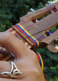 El Cuatro, Venezuelan musical instrument. El Cuatro, a typical Venezuelan musical instrument, made of wood and strings, with inlaid wood decorations and tricolor Royalty Free Stock Photos