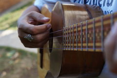El Cuatro, Venezuelan musical instrument. El Cuatro, a typical Venezuelan musical instrument, made of wood and strings, with inlaid wood decorations and tricolor Royalty Free Stock Image