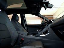 El cuero negro arregló asientos delanteros con la puntada azul del hilo en interior del coche imagen de archivo libre de regalías