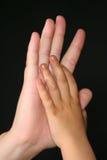 El cuidar jugando las manos Foto de archivo libre de regalías