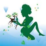 El cuidar para la naturaleza bajo la forma de muchacha con un árbol Imágenes de archivo libres de regalías