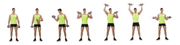 El culturista rasgado muscular con pesas de gimnasia imagen de archivo libre de regalías