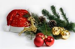El día de fiesta de la Navidad y del Año Nuevo presenta el ajuste con el sombrero de Papá Noel celebración Blanco aislado Fotos de archivo