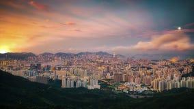 El día de la salida del sol a la noche tiró Hong-Kong y Kowloo Imagenes de archivo