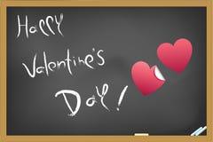 El día de tarjeta del día de San Valentín feliz escribió en la pizarra Fotografía de archivo