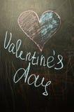 El día del ` s de la tarjeta del día de San Valentín está en el consejo escolar Fotografía de archivo