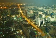 El día y la noche cambian en una ciudad grande Fotos de archivo libres de regalías