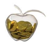 El dólar del oro acuña dentro de un vidrio de la manzana Imagenes de archivo