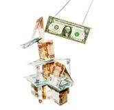 El dólar rompe la casa construida de los escombros Imágenes de archivo libres de regalías
