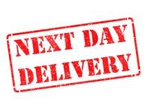 El día siguiente entrega en sello de goma rojo. Imagen de archivo libre de regalías