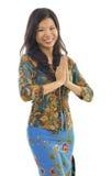 El dar la bienvenida asiático de los gestos de la mujer Foto de archivo libre de regalías