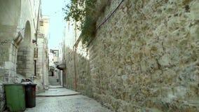 El dar un paseo en la ciudad vieja de Jerusalén
