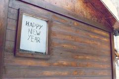 El ` de la Feliz Año Nuevo del ` de la inscripción en la ventana escarchada Imágenes de archivo libres de regalías