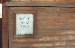 El ` de la Feliz Año Nuevo del ` de la inscripción en la ventana escarchada Fotos de archivo libres de regalías