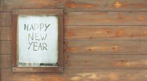 El ` de la Feliz Año Nuevo del ` de la inscripción en la ventana escarchada Fotos de archivo