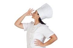 El decir bonito de la muchacha del cocinero delicioso imágenes de archivo libres de regalías