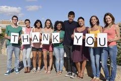 El decir del grupo de personas agradece Foto de archivo