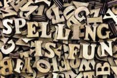 El deletreo es pila de las letras de madera de la diversión Fotos de archivo