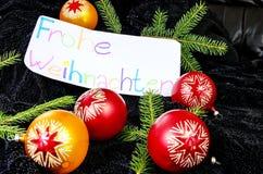 El deseo de la Feliz Navidad en alemán Fotografía de archivo libre de regalías