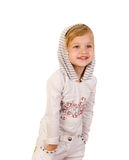 El desgastar feliz sonriente de la niña pantalones vaqueros blancos Fotos de archivo