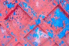 El desmenuzar superficial de la pintura vieja pintada Fotos de archivo libres de regalías