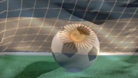 El despedir de balón de fútbol en hierba mientras que ondas argentinas de la bandera en el primero plano en campo de fútbol ilustración del vector