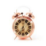 El despertador despierta tiempo aislado en el fondo blanco Foto de archivo libre de regalías