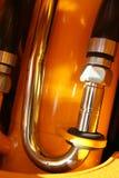 El detalle chromeplated del sistema hydráulico de un alimentador Foto de archivo libre de regalías