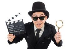 El detective joven con la tablilla y la lupa fotografía de archivo