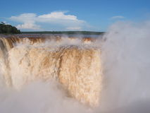 El Diabolo. Iguassu waterfalls on a sunny day early in the morning. The biggest waterfalls on earth Stock Photo