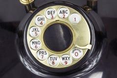 El dial de un teléfono de dial rotatorio fotografía de archivo