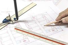 El dibujo del proyecto de los planes arquitectónicos y blueprints los rollos Fotografía de archivo