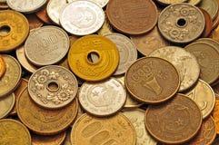 El dinero asiático acuña el fondo Foto de archivo libre de regalías