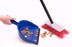 El dinero barre en un recogedor de polvo Imagen de archivo libre de regalías